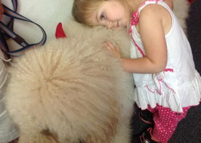 Sadie hugs the therapy dog special guest at EduCare