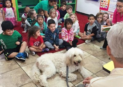 EduCare Special guest, therapy dog sits in front of the classroom
