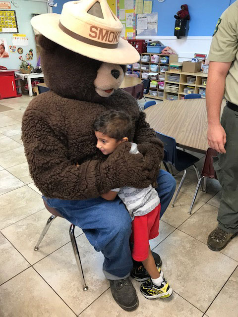 Smokey the Bear visits EduCare Learning Center.